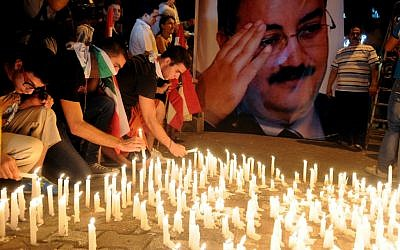 Lebanese mourners light candles during a vigil for Brig. Gen. Wissam al-Hassan and at least seven others who were killed in a Friday bomb attack in Beirut, Saturday, October 20, 2012. (photo credit: AP/Ahmad Omar)
