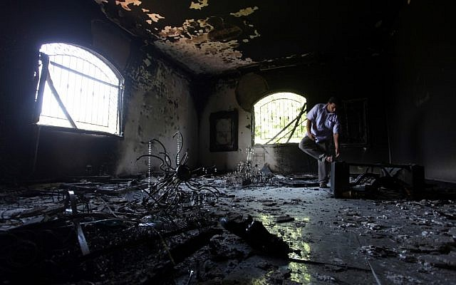 A Libyan man investigating the inside of the consulate the day after the Sept. 11 attack. (photo credit: AP/Mohammed Hannon)