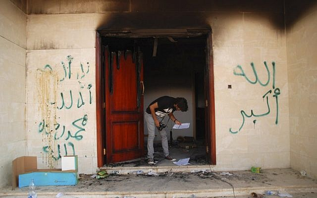An investigator searching the US consulate in Benghazi the day after the Sept. 11 attack. (photo credit: AP/Ibrahim Alaguri)