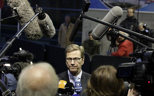 German Foreign Minister Guido Westerwelle, center, speaks with the media as he arrives for a meeting of EU Foreign Ministers in Luxembourg on Monday Oct. 15, 2012 (photo credit: AP Photo/Virginia Mayo)
