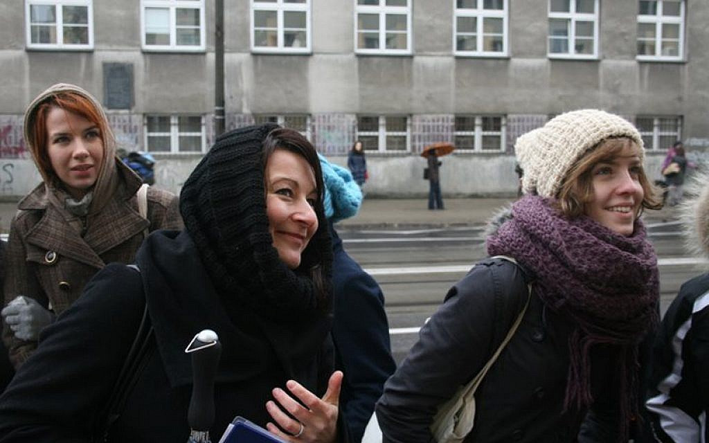 Martyna Majewska, center, guides a tour in Warsaw that shows former Jewish sites. (Marcin Kozlinski via JTA)