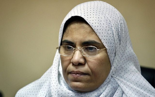 Sabah al-Saqari, 49, a senior member of the Freedom and Justice Party, the political arm of the Muslim Brotherhood, works at her office in the FJP's headquarters in Cairo, Egypt, Oct. 4 (photo credit: AP/Nasser Nasser)