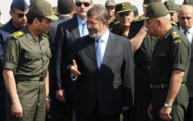 Egyptian President Mohammed Morsi with Minister of Defense, Lt. Gen. Abdel-Fattah el-Sissi, left, at a military base in Ismalia, Egypt, Wednesday(photo credit: AP/Egyptian Presidency)