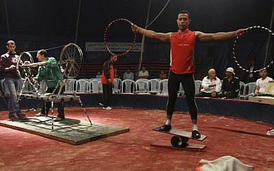 In this photo taken Thursday, Oct. 25, 2012, Mohammed Nassar, 33, right, a member of the Egyptian National Circus practices in Gaza City. (photo credit: AP)