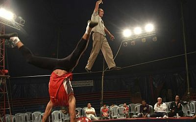In this photo taken Thursday, Oct. 25, 2012, Mohammed Nassar, 33, left, and Adel Aly, 47, members of the Egyptian National Circus practice in Gaza City. (photo credit: AP)