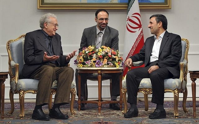 UN peace envoy to Syria, Lakhdar Brahimi, left, talks with Iranian President Mahmoud Ahmadinejad, during their meeting in Tehran, Iran, on Sunday, October 14, 2012. An unidentified interpreter sits at center (photo credit: AP/ISNA, Amir Pourmand)