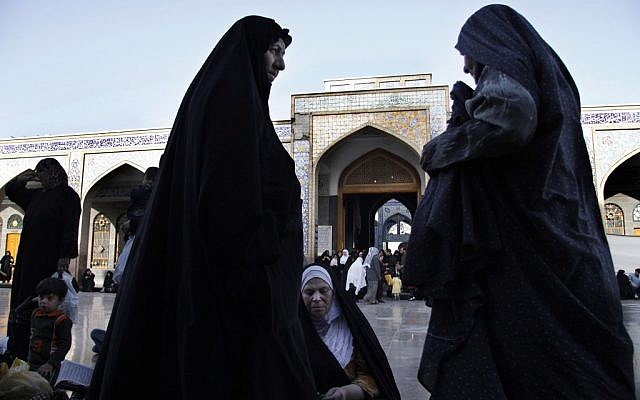 This April 22, 2009, file photo shows Iraqi women at the Sayda Zeinab shrine in southern Damascus, Syria (photo credit: AP Photo/Ola Rifai)