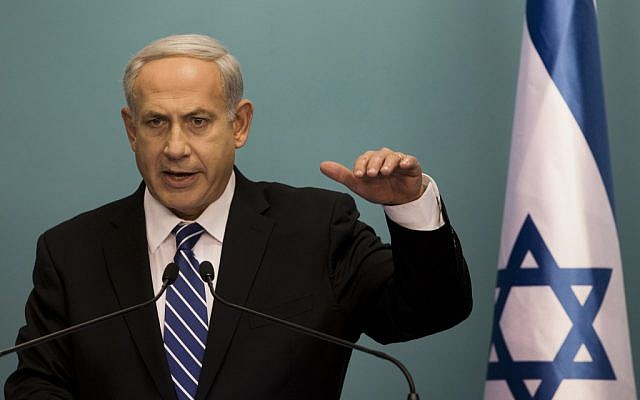 Prime Minister Benjamin Netanyahu announces early elections in a press conference Tuesday night (photo credit: AP/Bernat Armangue)