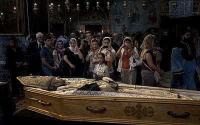 Armenians attend the funeral of the Armenian Patriarch of Jerusalem Torkom Manougian in the Old city of Jerusalem on Monday (photo credit: AP/Sebastian Scheiner)