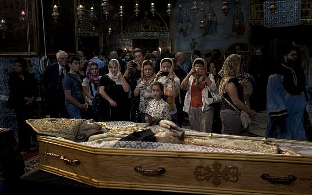 Armenians attend the funeral of the Armenian Patriarch of Jerusalem Torkom Manougian in the Old city of Jerusalem on Monday (photo credit: AP/Sebastian Scheiner)
