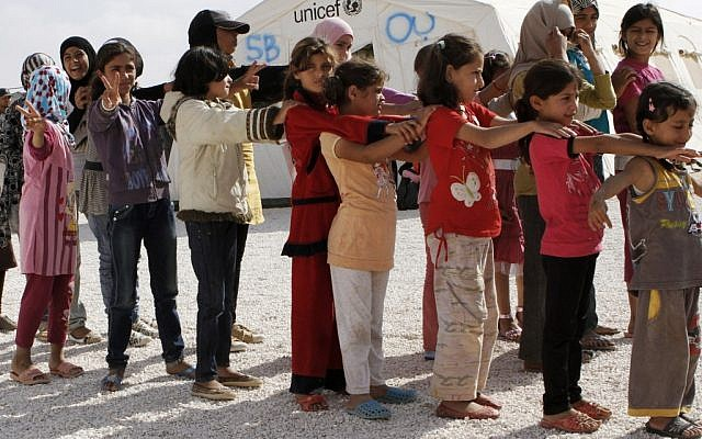 Syrian refugee children stand in line before attending class at the Zaatari refugee camp in Mafraq, Jordan, on Thursday, October 4, 2012 (photo credit: AP Photo/Raad Adayleh)
