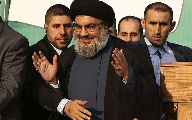 Hezbollah chief Hassan Nasrallah waves to supporters in southern Beirut, September 17 (photo credit: AP/Hussein Malla)