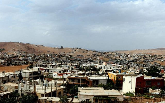 A view of Arsal, a Sunni Muslim town in eastern Lebanon near the Syrian border that has become a safe haven for war-weary Syrian rebels, a way station for wounded fighters and home to hundreds of frightened Syrian refugee families (photo credit: AP Photo/Bilal Hussein)
