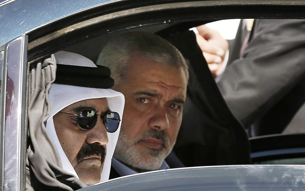 Qatari Emir Sheikh Hamad bin Khalifa al-Thani, left, and Gaza's Hamas prime minister Ismail Haniyeh, right, arrive for a cornerstone-laying ceremony for Hamad, a new residential neighborhood in Khan Younis, southern Gaza Strip, October 23, 2012. AP/Mohammed Salem.