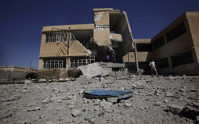 A school near Aleppo damaged by government bombing, September 16 (photo credit: AP/Muhammed Muheisen)