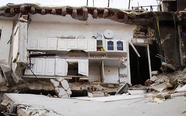 A house destroyed by Syrian government shelling in Homs province, Syria on Thursday (photo credit: AP/Lens Yong Homsi)