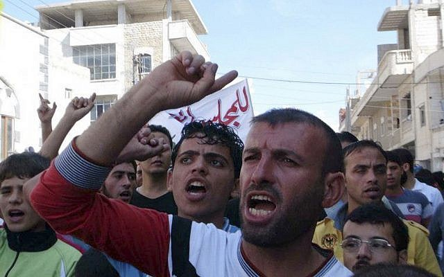 Anti-Assad protest in the village of Binnish, near Idlib in northern Syria, October 12 (photo credit: AP)