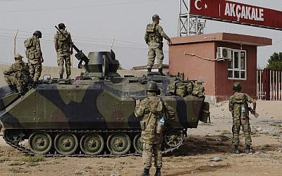 A Turkish military station at the border gate with Syria, October 7 (photo credit: AP)