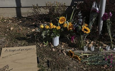 An informal memorial for shooting victims stands outside Accent Signage Systems, Inc. in Minneapolis, Minnesota on Saturday (photo credit: AP/The Star Tribune)