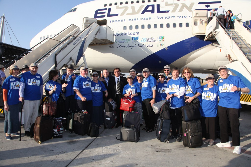 A group of retirees gathers after arriving in Israel in August, part of an aliya trip organized by Nefesh B'Nefesh. (Photo credit: Nefesh B'Nefesh via JTA)