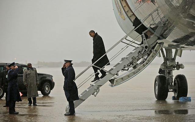 President Barack Obama steps off Air Force One upon his arrival at Andrews Air Force Base, Md., Monday, Oct. 29, 2012. (photo credit: Pablo Martinez Monsivais/AP)