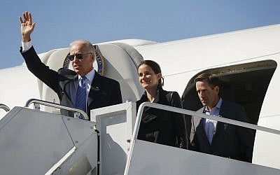 Vice President Joe Biden, left, followed by his daughter Ashley Biden, center, and son Beau Biden, right, walk out of Air Force Two upon their arrival at Lexington Blue Grass Airport, Thursday, Oct. 11, 2012, in Lexington, Kentucky, in 2012 (photo credit: Pablo Martinez Monsivais/AP)