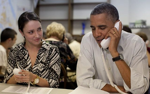 US President Barack Obama makes phone calls to volunteers on Sunday in Williamsburg, Virginia (photo credit: AP/Carolyn Kaster)