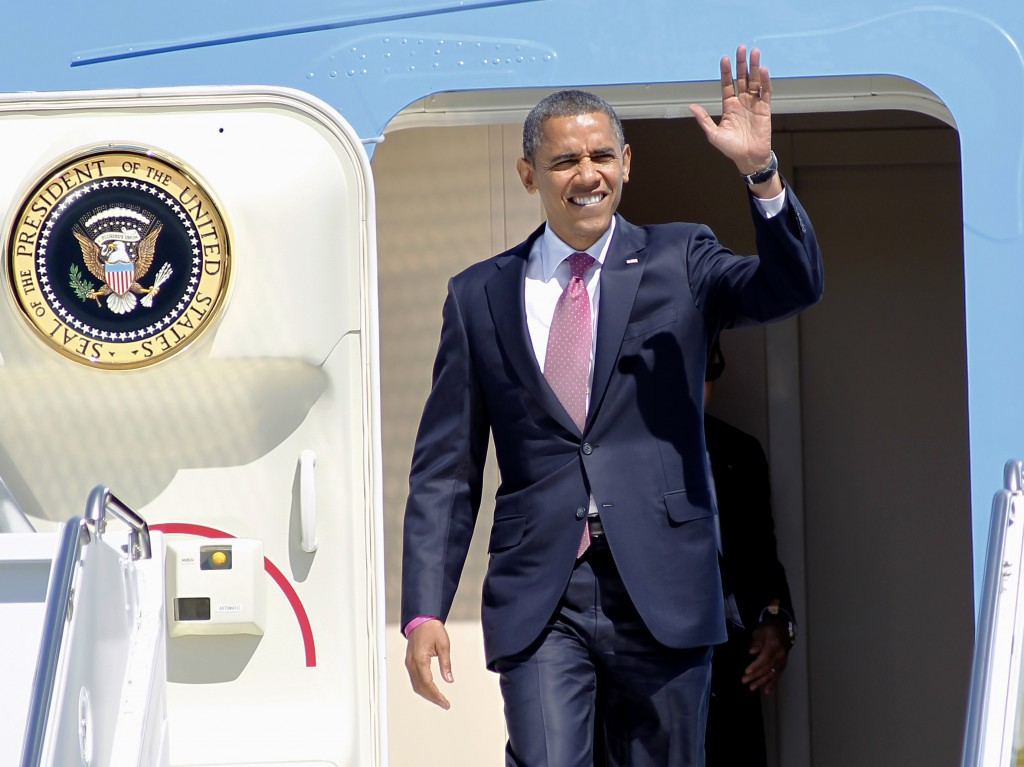 President Barack Obama waves after arriving on Air Force One at West Palm Beach Airport in West Palm Beach, Fla., Monday, Oct. 22, 2012, ahead of his final debate tonight against Republican presidential candidate, former Massachusetts Gov. Mitt Romney at Lynn University in Boca Raton, Fla. (photo credit: Terry Renna/AP)