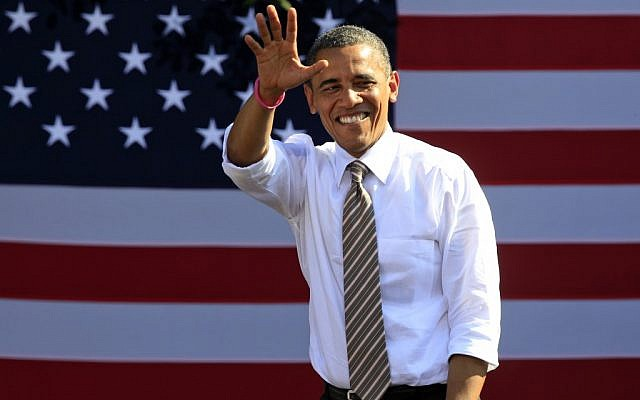US President Barack Obama waves to supporters during a campaign rally in Byrd Park in Richmond, VA., Thursday, October 25, 2012. (photo credit: Steve Helber/AP)