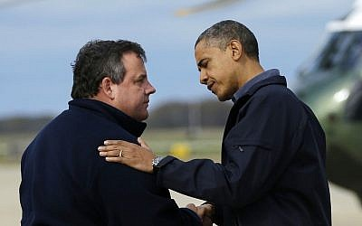 President Barack Obama is greeted by New Jersey Gov. Chris Christie upon his arrival at Atlantic City International Airport, Wednesday, October 31, 2012, in Atlantic City, New Jersey (photo credit: Pablo Martinez Monsivais/AP)