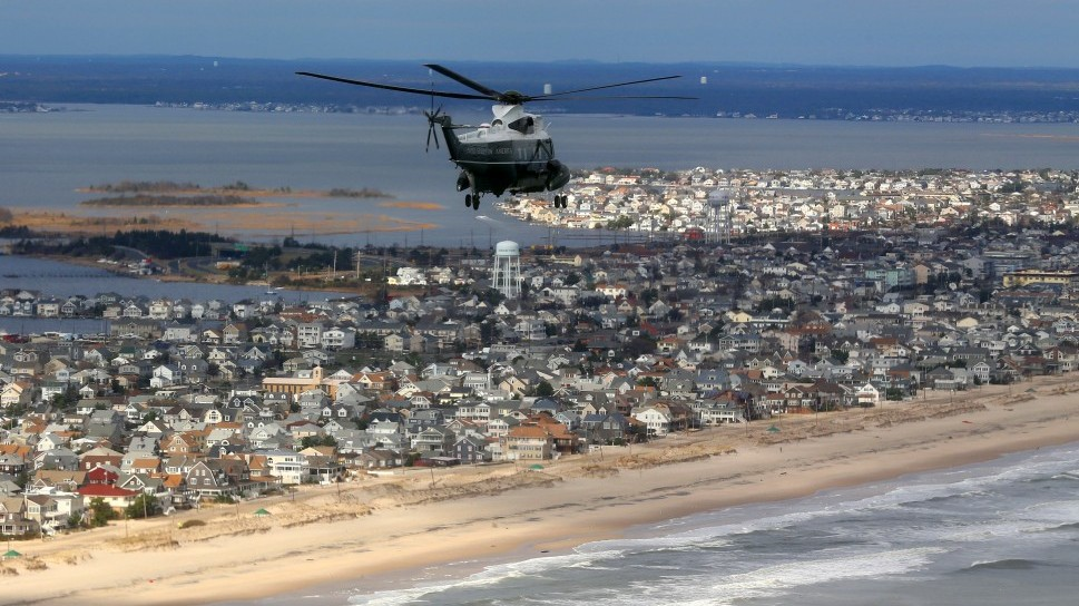 Marine One, carrying President Barack Obama and New Jersey Gov. Chris Christie, take an aerial tour of the Atlantic Coast in New Jersey in areas damaged by superstorm Sandy, Wednesday, Oct. 31, 2012 (photo credit:Doug Mills/ AP/ Pool)