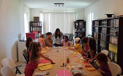 Rachel Druk (at the head of the table) gives a class at home for the local Jewish children (photo credit: courtesy of Chabad Cancun)