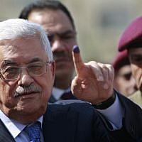 Palestinian Authority President Mahmoud Abbas shows his ink-stained finger after casting his vote during local elections at a polling station in the West Bank city of Ramallah, October 20, 2012. (AP/Majdi Mohammed)