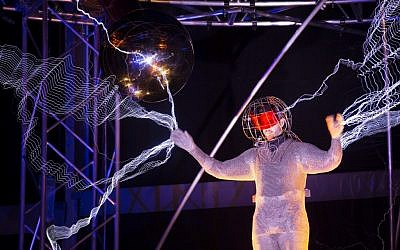 Magician David Blaine stands inside an apparatus surrounded by a million volts of electric currents streamed by tesla coils during his 72-hour 'Electrified: 1 Million Volts Always On' stunt on Pier 54, Friday, Oct. 5, 2012, in New York (photo credit: AP/John Minchillo)