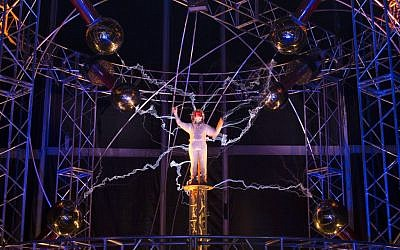 "Magician David Blaine stands inside an apparatus surrounded by a million volts of electric currents streamed by Tesla coils during his 72-hour ""Electrified: 1 Million Volts Always On"" stunt on Pier 54, Friday, Oct. 5, 2012 (photo credit: AP/John Minchillo)"
