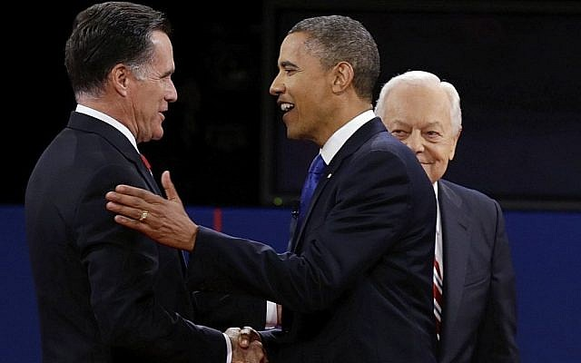 President Barack Obama and Republican challenger Mitt Romney shake hands at Monday night's foreign policy debate, while moderator Bob Schieffer looks on (photo credit: Charlie Neibergall/AP)