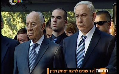 President Shimon Peres and Prime Minister Benjamin Netanyahu attend the memorial service for slain prime minister Yitzhak Rabin at Mt. Herzl cemetery in Jerusalem Sunday, Oct. 28, 2012. (screen capture: Channel 10)