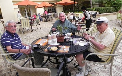 Residents of MorseLife, a Jewish retirement community in West Palm Beach, Fla., start the day with an outdoor breakfast. (Photo credit: Courtesy of MorseLife via JTA)