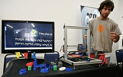 A member of the XLN staff shows off an open-source 3D printer (Photo credit: Courtesy)