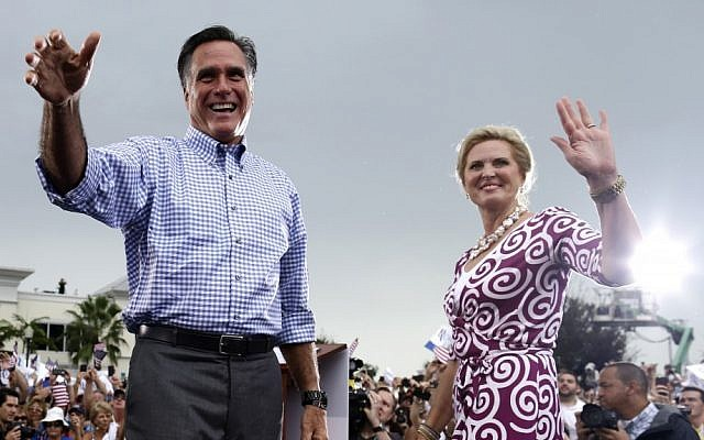 Republican presidential candidate and former Massachusetts governor Mitt Romney and wife Ann campaign in Florida on Sunday (photo credit: AP/Charles Dharapak)