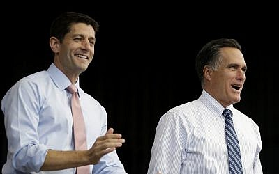 Republican presidential candidate, former Massachusetts Gov. Mitt Romney, right, and his vice presidential running mate, Rep. Paul Ryan, R-Wis., takes the stage at a campaign stop, Tuesday, Oct. 23, 2012, in Henderson, Nev. (photo credit: David Goldman/AP)