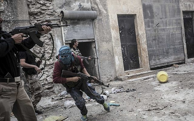 Syrian rebels confront government troops in Aleppo in late October (photo credit: AP/Narciso Contreras)