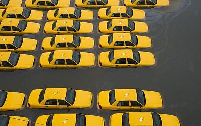 Taxis in a flooded parking lot in Hoboken, New Jersey. (AP/Charles Sykes)