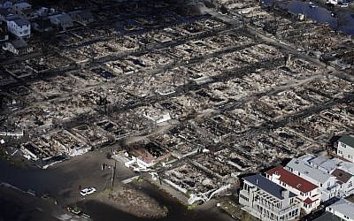 This aerial photo shows the Breezy Point neighborhood, in New York, Wednesday, Oct. 31, 2012, where more than 50 homes were burned to the ground Monday night as a result of superstorm Sandy. Sandy, the storm that made landfall Monday, caused multiple fatalities, halted mass transit and cut power to more than 6 million homes and businesses. (Mark Lennihan/AP)