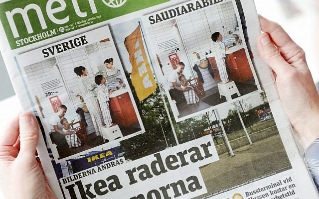 Person holds the Monday issue of daily Metro fronted with two images from Swedish and Saudi Arabian IKEA catalogue for next year. Ikea is being criticized for deleting images of women from the Saudi version of its furniture catalogue, a move the company says it regrets. Comparing the Swedish and Saudi versions of the Ikea catalogue, Sweden's free newspaper Metro on Monday showed that women had been airbrushed out of otherwise identical pictures showcasing the company's home furnishings. The headline reads Ikea Erase Women. (AP Photo/Scanpix Sweden/Henrik Montgomery)