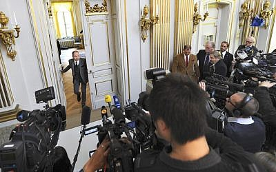 Peter Englund, permanent secretary of the Royal Swedish Academy, arrives to announce that Chinese writer Mo Yan has been named the winner of the 2012 Nobel Prize in literature on October 11 in Stockholm. (photo credit: AP/Fredrik Sandberg)