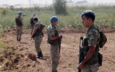 Turkish commandos stand near the Turkish-Syrian border in Akcakale, Turkey, October 2012 (photo credit: AP)