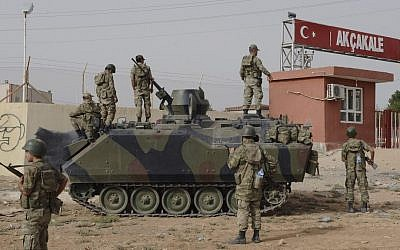 Turkish troops stationed at the border gate with Syria in Akcakale, Turkey (photo credit: AP)