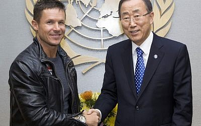 Austrian skydiver, base jumper and daredevil Felix Baumgartner, left, and United Nations Secretary General Ban Ki-moon pose for photographers at United Nations Headquarters, Tuesday, Oct. 23, 2012. (photo credit: The United Nations, Rick Bajornas/AP)