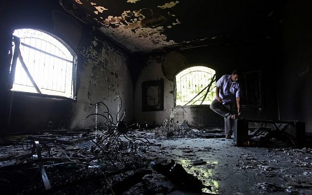 A Libyan man investigates the inside of the US Consulate in Benghazi, Libya, after an attack that killed four Americans, including Ambassador Chris Stevens on the night of Tuesday, Sept. 11, 2012 (photo credit: AP/Mohammad Hannon/File)